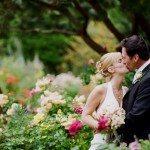 wedding couple kissing in a garden